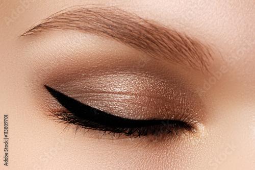 Fotografia Cosmetics & make-up. Beautiful female eye with sexy black liner