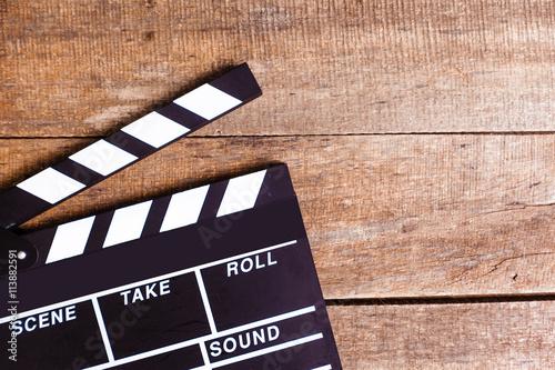 Valokuva photo of movie clapper on wood