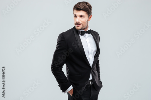 Canvas Print Attractive young man in tuxedo and bowtie