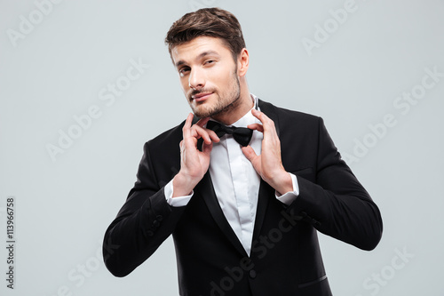 Canvas Print Portrait of handsome young man in tuxedo with bowtie