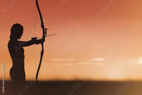 Fotografija Side view of woman practicing archery