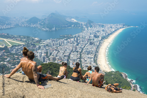 People enjoying the scenic overlook of Rio de Janeiro, Brazil from the top of Two Brothers Mountain
