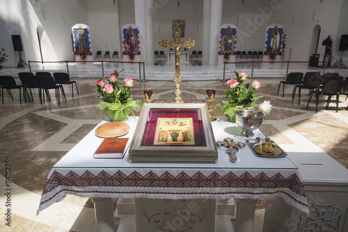 Canvas Print Baptising in church. Orthodox christening