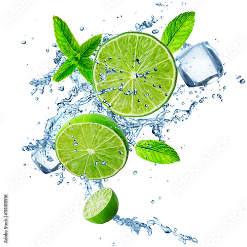 Fresh limes in water splash.