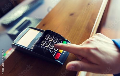hand entering password to bank terminal Fototapeta