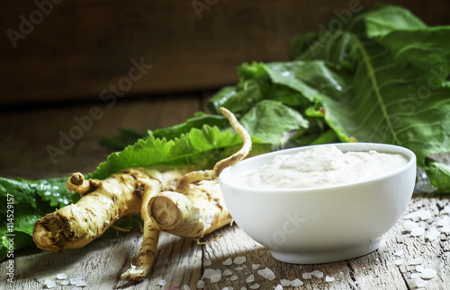 Ground horseradish, hot sauce to the food in a white bowl, roots Fototapet