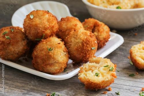 Fototapeta Fried Mac and cheese balls, selective focus