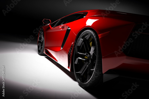 Fototapeta premium Czerwony szybki samochód sportowy w centrum uwagi, czarne tło. Błyszczące, nowe, luksusowe.