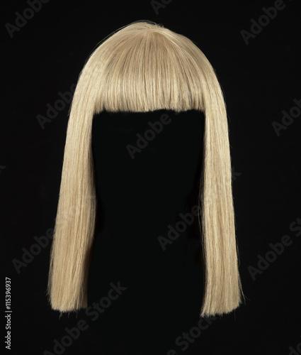 Obraz na płótnie female blonde wig on a black background
