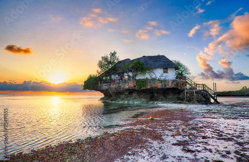 Fotografia, Obraz Restaurant the Rock at sunrise in the Indian ocean in Zanzibar,