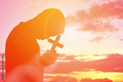 Fototapeta Silhouette people jesus and cross at sunset