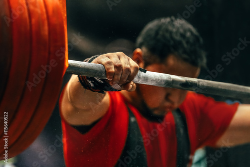 Wallpaper Mural male powerlifter preparing for squats with a barbell during competition of power