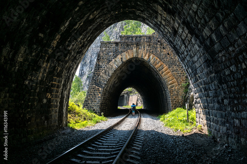 tourist goes by rail through the tunnels