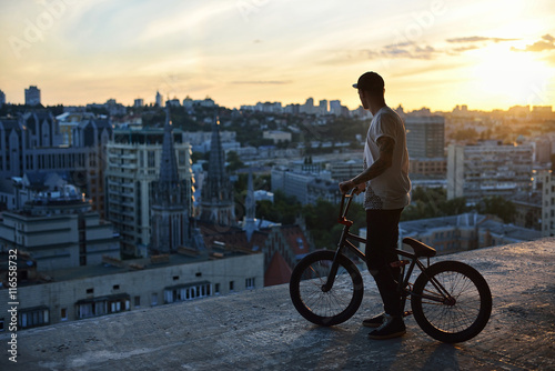 Bmx freestyle. Standing with his bmx.