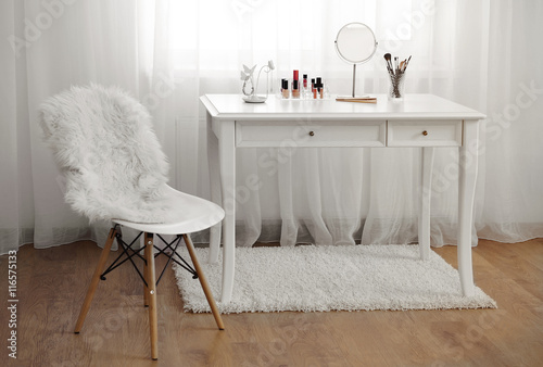 Obraz na płótnie Dressing table with cosmetics in room