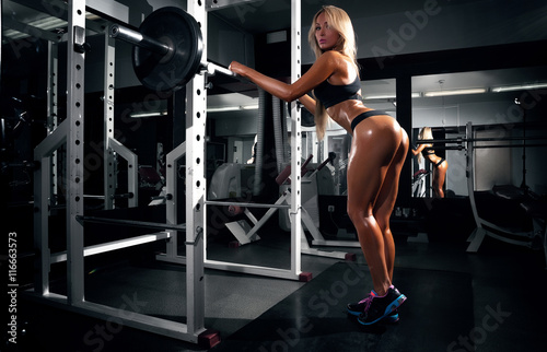 Back view of blondi sexy fitness girl