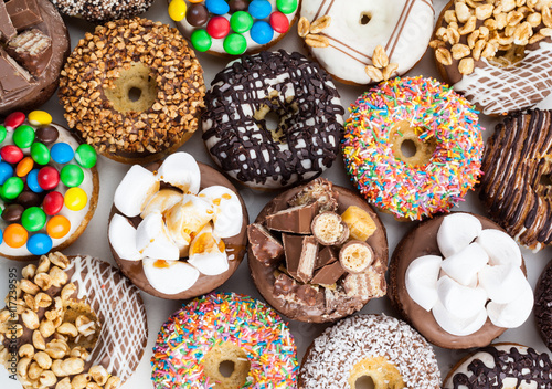 Close up of a selection of colorful donuts. Fototapeta