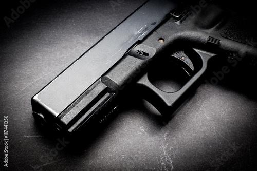 Obraz na płótnie hand gun on black background