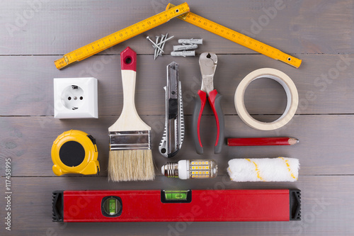 DIY construction tools on wooden background