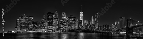 Foto Murales New York City Manhattan downtown skyline at dusk with skyscraper