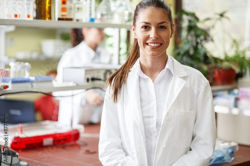 Obraz na plátně Young female  scientist  standing in her lab.