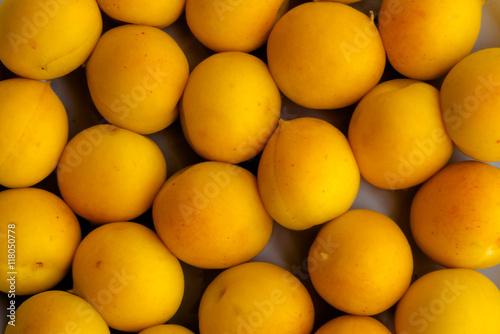 Slika na platnu Fresh yellow apricot background texture.