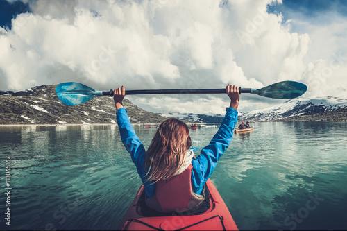 Wallpaper Mural Woman kayaking on Styggvatnet glacier lake near Jostedalsbreen glacier
