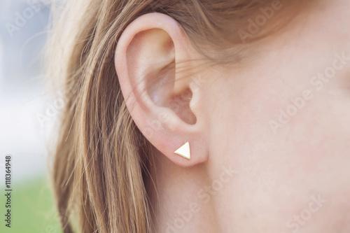 Fotografiet Woman ear wearing beautiful luxury earring