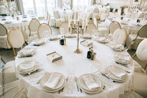 Tablou Canvas Elegant wedding reception white table arrangement restaurant,  candlestick on table