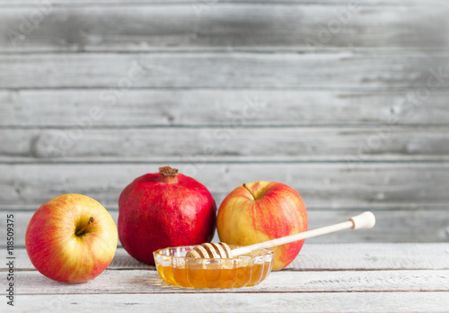 Wallpaper Mural Pomegranate, apples and honey on white wooden table - traditional symbols of the