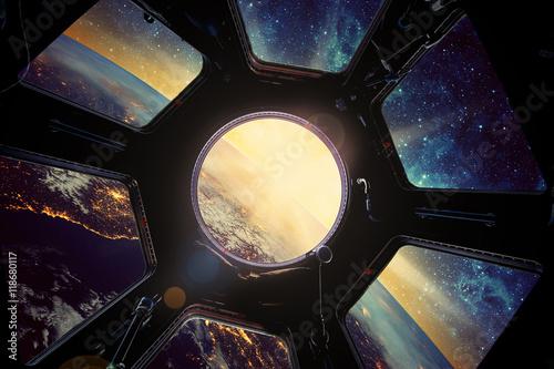 Fototapeta Earth and galaxy in spaceship window porthole