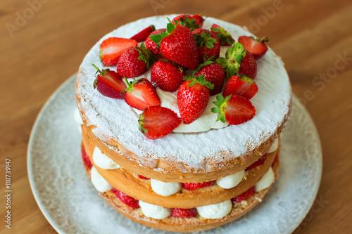 Obraz na plátne Homemade cake with strawberry and cream.