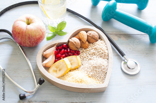 Healthy food in heart and water diet sport lifestyle concept