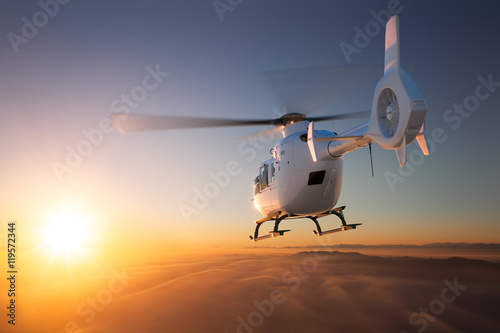 Helicopter Sunset Flight Fototapeta