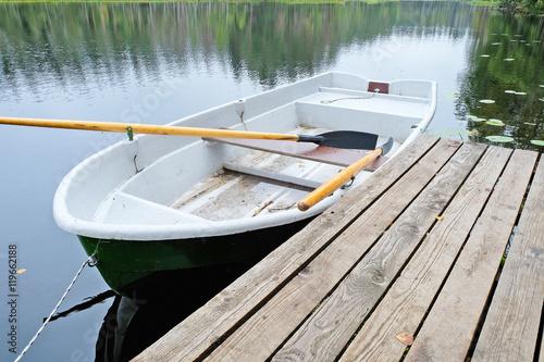 Obraz na płótnie rowing boat at the pier