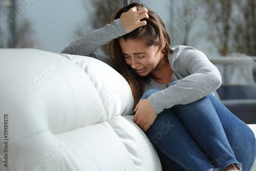 Photo Sad girl crying alone at home