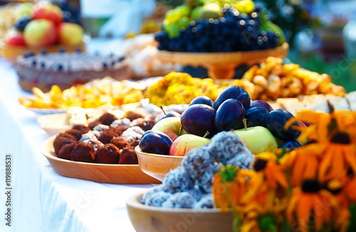 Obraz na plátne Beautiful wedding feast in nature, abundance of meals on a table.