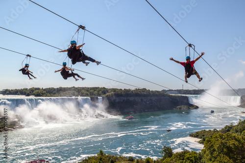 Photo Four unrecognizable people taking zipline ride at Niagara Falls, Ontario