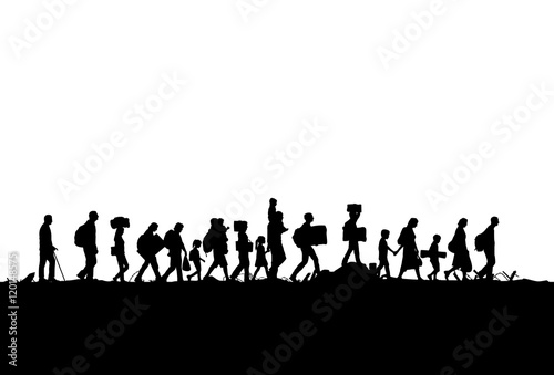 Canvas-taulu Silhouette of a group of refugees walking through a field
