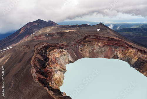 Maly Semyachik is a stratovolcano with acidic crater lake Fototapeta