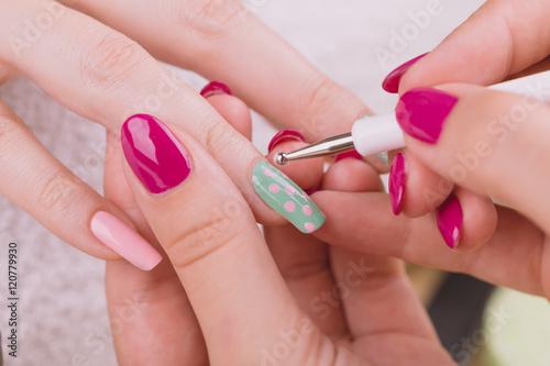 Fotografija Manicure - Beauty treatment photo of nice manicured woman fingernails