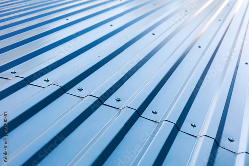 Stampa su Tela blue corrugated metal roof with rivets, industrial background