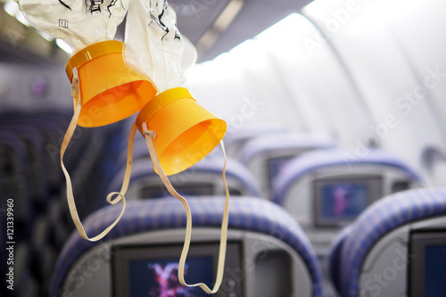 Photo cabin oxygen mask drop from the cabin ceiling