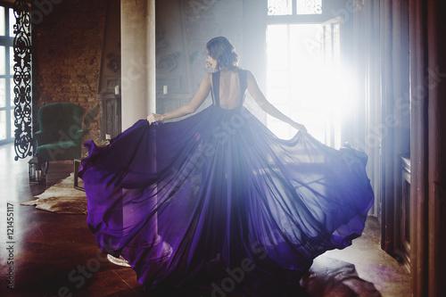 Stampa su Tela Beauty Brunette model woman in evening purple dress