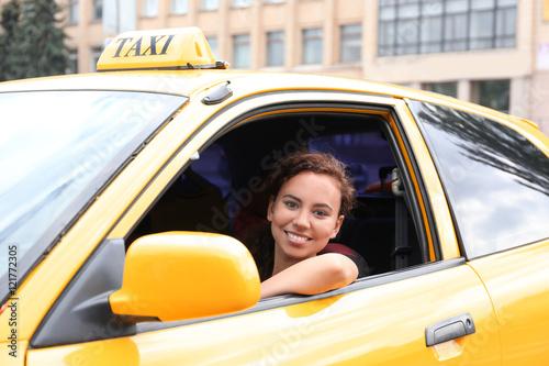 Obraz na plátne Female taxi driver in car