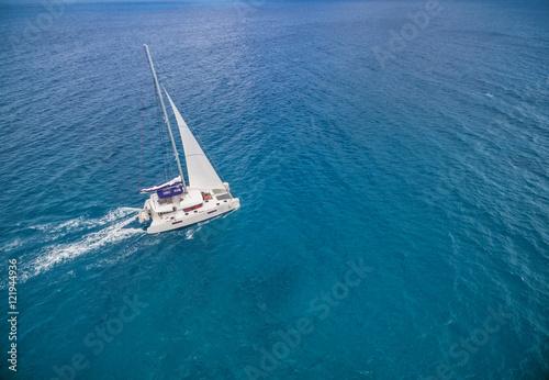 Aerial view of catamaran sailling in ocean Fotobehang