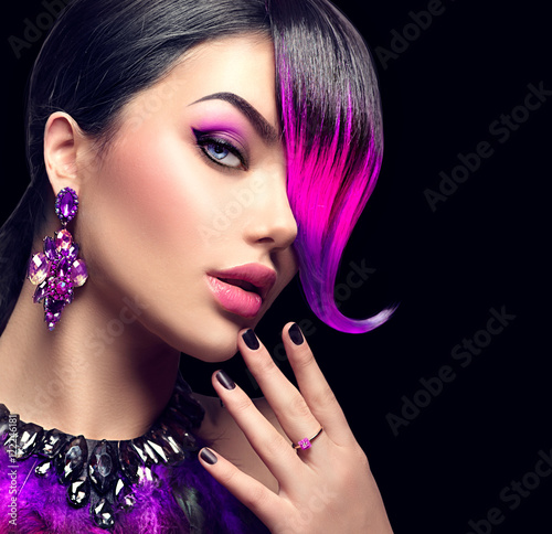 Sexy beauty fashion woman with purple dyed fringe hairstyle isolated on black background