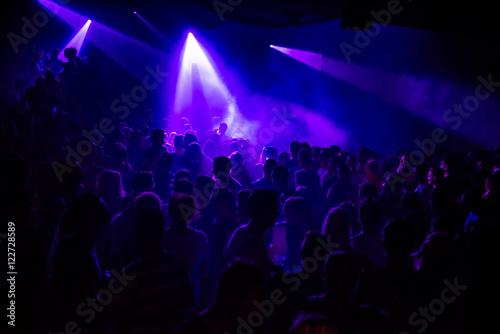 Purple lights in a crowded club