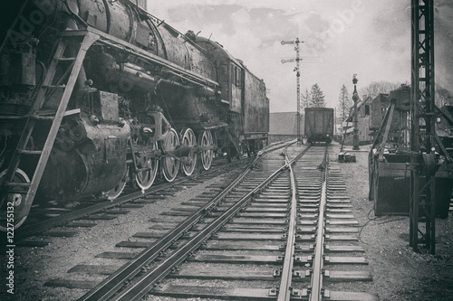 The stylized image of an old steam locomotive at the station