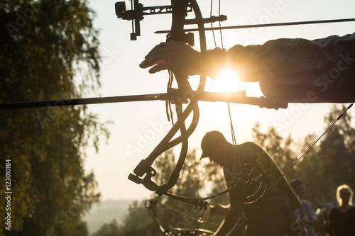 Fotografija Archers silhouettes on forest background